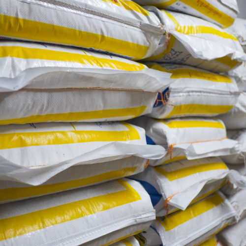 Pile of sack in warehouse. Background and texture of sack stack in warehouse.